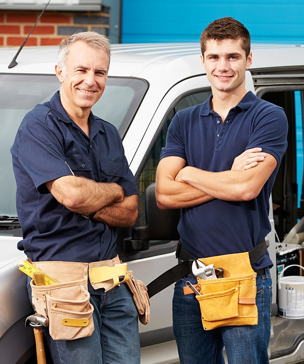 Two Plumbers in front of service car - Tom's Plumbing and Drain Service, LLC