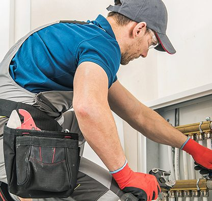 Plumber Working - Tom's Plumbing and Drain Service, LLC