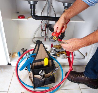 plumber fixing gas line