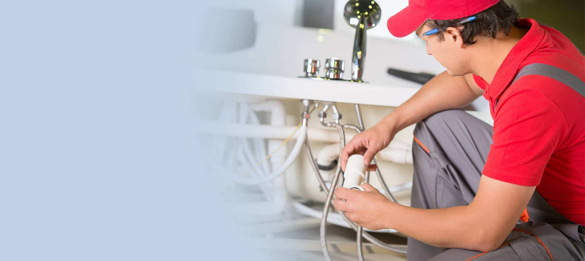 plumber fixing pipe lines - Tom's Plumbing and Drain Service, LLC