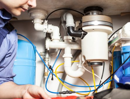 Plumber at work -Tom's Plumbing & Drain Service, LLC