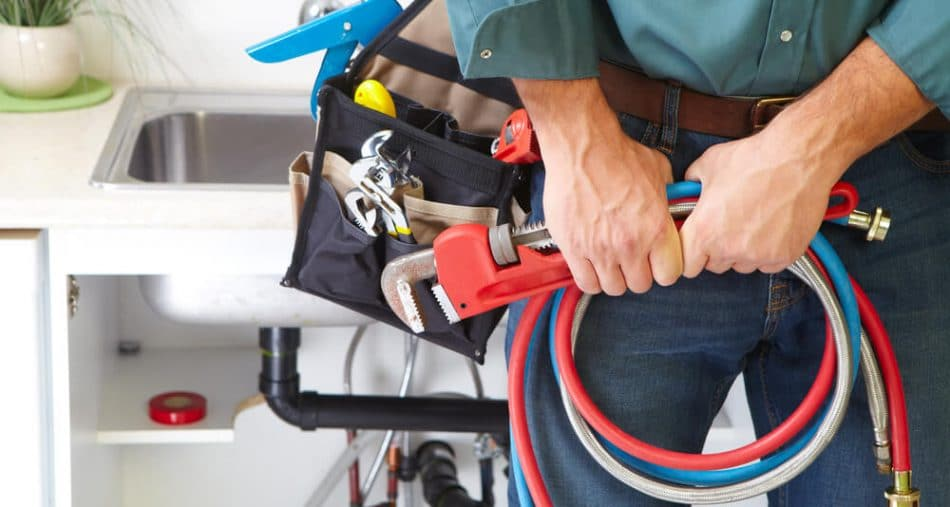 Plumber with set of tools - Tom's Plumbing